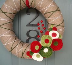 Yarn Wreath. Seems like it would be fairly easy to figure out myself.