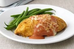 Oven-baked chicken with a crispy coating and a simple sauce.