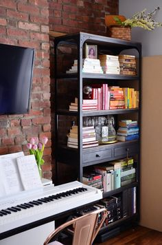 When open shelves are just a necessary part of your apartment's storage plan, you end up forced to fill them with your things. And I don't need to tell you that can get kind of messy. You have two options: You can get rid of half your stuff, or just get better at styling it. 5 Smart Ways to Style and Organize Open Shelves.