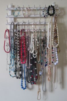 Thread rack necklace holder! Spray paint a thread rack (mine came from a thrift store) and attach to wall. Easily hang necklaces and bracelets! No more tangles in your jewelry box!