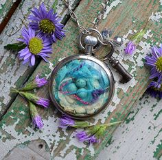 Isn't this repurposed old watch cool?  She has some really interesting things in her Etsy shop.                          Pocket Watch Nest Necklace - the Nest