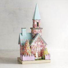 Celebrate the beauty of the Easter season with our hand-painted church. It's a pre-lit, pastel pillar of the community—glowing and glittery, with a steeple and a pink picket fence.