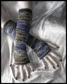 http://www.etsy.com/listing/59785199/paris-at-dusk-lace-arm-warmers-smokey?ref=cat2_gallery_21