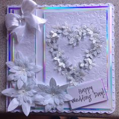 Wedding card using spellbinders embossing flourish and  flower heart stamp by chloe