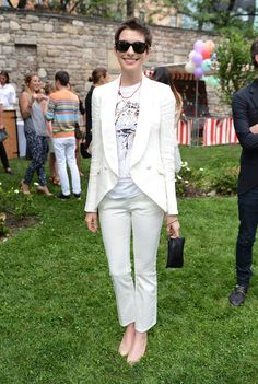 Anne Hathaway Red Carpet Evolution | looked sleek and chic donning a white Stella McCartney pantsuit for the designer's Spring 2012 presentation dinner in NYC.