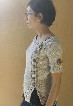 Love this buttony sweater--free Ravelry pattern!