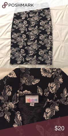 LuLaRoe Cassie skirt - black/cream floral I love the Cassie skirt by LuLaRoe! It's truly the perfect pencil skirt. Not only is it super comfortable thanks to the stretch material (I've worn mine all day at work and then out for happy hour), it can also be dressed up or down. Heels or flats. Blouse or cute tee. It's seriously the most versatile piece! This one is in excellent condition (only worn once)! The cream and black floral pattern is so beautiful! I'm trying to clear out a bunch of my…