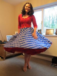 Having a spin! 1950s Halterneck circle dress in royal white spot with red petticoat by Vivien of  Holloway. http://www.vivienofholloway.com/ #VivienofHolloway #VivienHolloway #VoH #Vintagereproduction #madeinlondon #1950sstyle #1950sfashion #1950s #1950sglamour #pinupgirl #pinup #rockabilly #rockabillygirl #rockabillyclothing #pinupfashion