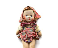 Vintage cloth doll with a painted face