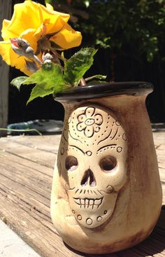 My skull vase came out of the kiln today. I love it.
