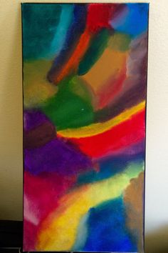 This is a abstract blue yellow green red purple and orange oil painting, that was painted and blended entirely by hand. No paintbrushes or palate