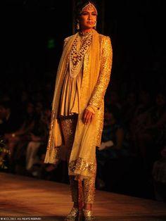 Carol Gracias walks the ramp for designer Sabyasachi on Day 1 of Delhi Couture Week, held in New Delhi, on July 31, 2013.
