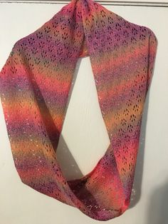 Rainbow colored lace infinity scarf.