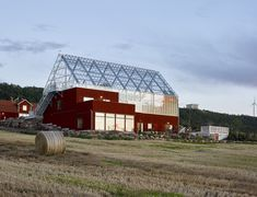 A conference/cafe/event- building in Uppgränna, Sweden. An existing red barn was demolished and replaced by a modern building with ground floor partly submerged in the slope. The upper entrance level consists of an insulated building partly surrounde