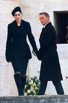 Daniel Craig and Monica Bellucci were spotted shooting a funeral scene in Rome for Spectre.