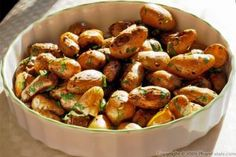 """Fingerling potatoes are a small (probably the smallest) variety of potatoes. They have a very cute, narrow shape. The flesh is firm and yellow. They are not too starchy like Russet potatoes. I love roasting them and serving them as appetizers. It\'s a perfect bite-sized amuse-bouche, which literally means """"playful in the mouth"""" in French. They will be a hit at your next fancy dinner party."""