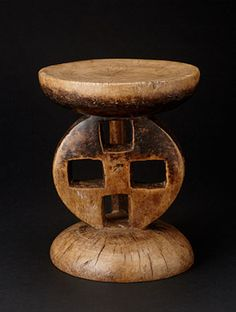"""Tonga stool from Zimbabwe. Not only is it a decorative sculpture, it is also incredibly comfortable to sit on! H : 10.75 x DIAM : 8.75"""" www.africaandbeyond.com"""