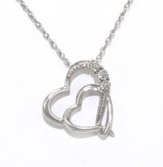 (http://shop.shinjewelers.com/18-sterling-silver-diamond-double-heart-necklace-83010405/)