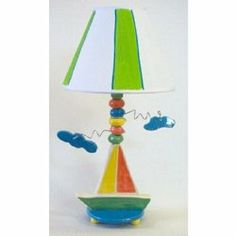 """Sailboat Lamp by Ababy. $74.00. 18"""" H including shade. Recommended Wattage: 60. Sail AwayOur Sailboat Lamp is all nautical The cheerful colors and hand painted design make for a youthful lamp to enhance your room A circular base supports a ceramic sailboat, from which a beaded stem rises and finishes in a striped shade. Wiry arms with hanging clouds complete the look. Perfect for your little boy"""