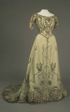Evening Dress of Empress Alexandra Fyodorovna, by Auguste Brisac's Workshop, St. Petersburg, early 20th century, at the State Hermitage Museum. Lace, silk, spangles and paste.
