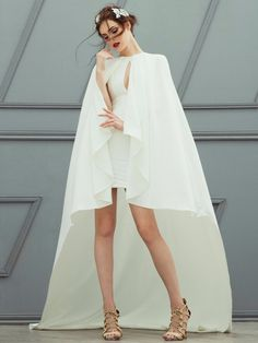 Huge White Cape Covering Dainty White Dress | Fashion Friday: Patty Ang Bridal 2016 | http://brideandbreakfast.ph/2016/10/14/fashion-friday-patty-ang-bridal-2016/