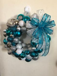 Teal, silver, and white Christmas ornament wreath on inch floral foam ring with matching bow. Blue Christmas Decor, White Christmas Ornaments, Frozen Christmas, Christmas Ornament Wreath, Cool Christmas Trees, Christmas Tree Toppers, Holiday Wreaths, Christmas Tree Decorations, Christmas Door