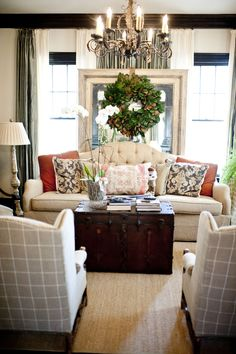 love the wing back chairs and fabric!  ...and the sofa. not really diggin the wreath tho