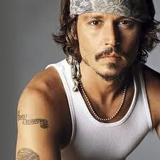Johnny Depp. I really like this picture of Johnny. It's composition is pretty cool..not to mention the white singlet (there it is again..)