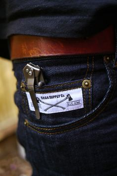 Quality dark denim, navy t-shirt, scuffed brown leather belt, and a small, clipping folder—comfortable, classic, and cool. Well done, sir.