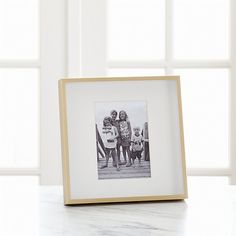 Shop Brushed Brass 5x7 Frame.  Our brushed brass frame adds drama to photo displays with its shadow-box styling and oversized off-white mat.  Square frame can be displayed on the wall or tabletop.