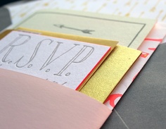 A closeup of our neon invite packaging - complete with edge-painting, a gold enclosure and pink Plike bellyband!