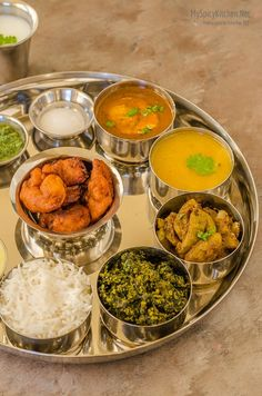 Maharashtrian Thali – Meal from Indian State of Maharashtra . Egg curry, Lentil stew (dhal), bottle gourd curry, spinach gram flour stir fry, shrimp fritters and creamy almond pudding are on the platter. Indian Food Recipes, Vegetarian Recipes, Cooking Recipes, Jain Recipes, Rice Recipes, Cooking Tips, Veg Thali, Maharashtrian Recipes, Food Platters