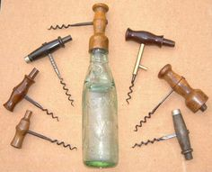 Direct pull corkscrews with Codd bottle openers - In 1870 Hiram Codd invented the Codd Bottle. His bottle was sealed by a glass marble,  held in position by the pressure of the gas in the liquid.    A number of corkscrews were later produced to incorporate a codd opener as well as the  corkscrew.