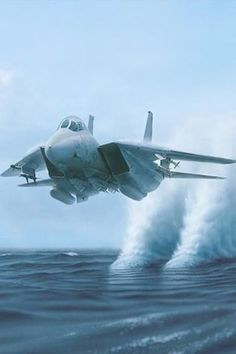 F14 Tomcat (water is pulled up after the engine intakes pass by). No actual vapour cone.