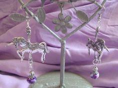 Licornes en metal argenté /perles fimo