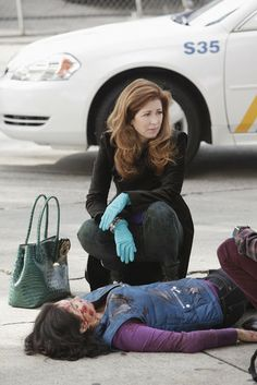 dr megan hunt (body of proof) favours great tailoring, structured handbags and mega high heels
