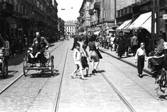 Warsaw, Poland, A street scene. Taken by the German photographer Willi George in the summer of 1941. The photographs are unique in that they were not staged, but showed the ghetto as it truly was.