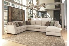Sophisticated and comfortable, Wilcot 4-piece sectional is a perfect fit for large gathering places. Designed for supreme comfort, with premium UltraPlush seat cushions bolstered by loose back cushions and decorative pillows. Classic roll arms and plush chenille upholstery soften the seating.