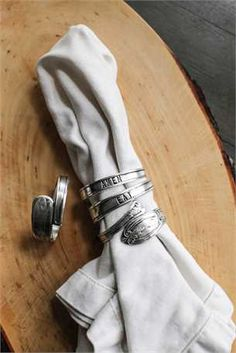 """Napkin rings with """"eat"""" and """"amen"""" from Curated Gatherings."""