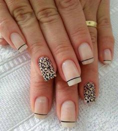Nude and white leopard nail art design with French tips. A simple and clean looking nail art design that looks wonderful with hints of yellow nail polish on the leopard prints.