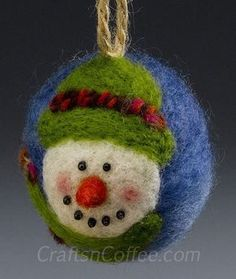 DIY Styrofoam Ball Christmas Ornament — This adorable needle felted snowman ornament is from Crafts 'n Coffee.