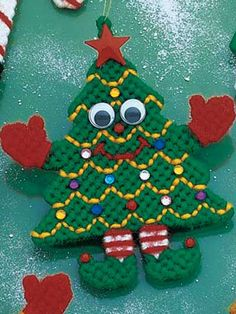 Plastic Canvas - Holiday & Seasonal Patterns - Christmas Patterns Uses plastic canvas, worsted yarn, moveable eyes and assorted jewels. Plastic Canvas Ornaments, Plastic Canvas Tissue Boxes, Plastic Canvas Crafts, Plastic Canvas Patterns, Crafts To Make, Holiday Crafts, Plastic Canvas Christmas, Canvas Designs, Craft Sale