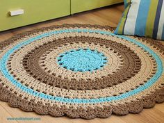 A doily rug that was made according to the   beautiful pin pattern => https://www.pinterest.com/pin/414331234443727238/   Made of T-Shirt yarn-Trapillo