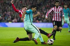 Luis Suarez of FC Barcelona duels for the ball with Aymeric Laporte of Athletic Club during the Copa del Rey Round of 16 first leg match between Athletic Club and FC Barcelona at San Mames Stadium on January 5, 2017 in Bilbao, Spain.