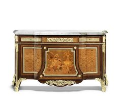 A French early 20th century Louis XVI style gilt-bronze mounted mahogany, marquetry and parquetry commode à vantaux after the model by Jean-Henri Riesener