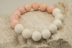 White and Peach Blossom Foam Coral Beads (approx 12mm) Bracelet.  Length is approximately 7,25 inches which fits most wrist size.  List price includes 1