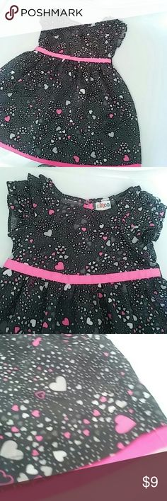 Circo Heart Dress (Size 2T) This beautiful charcoal grey dress is super cute for valentines day but still adorable any time of the year!  Good condition. Charcoal grey background with slightly darker grey hearts, light grey hearts, and hot pink hearts.  Hot pink trim and ribbon at waist! Circo Dresses
