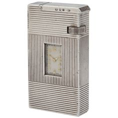 DUNHILL: A silver 'Broadboy Watch' lighter, by Alfred Dunhill, London 1938. Lot 99.