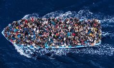 African asylum seekers packed into a boat.  Massimo Sestini