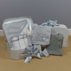 A neutral baby gift hamper perfect for corporate baby gift giving. Baby Gift Hampers, Baby Hamper, Dou Dou, Baby Comforter, Baby Wraps, Baby Socks, Corporate Gifts, Baby Bodysuit, Baby Gifts